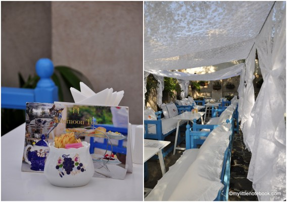 white and blue art cafe garden restaurant in former bastakiya quarter, dubai