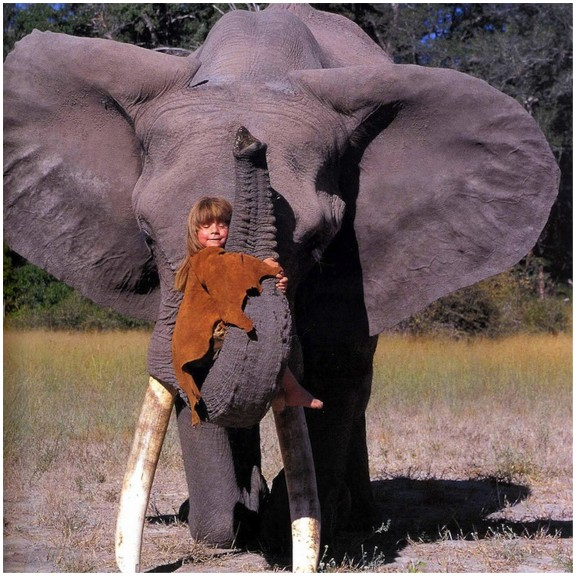 a girl with an elephant