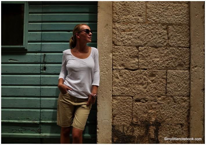 exploring streets of Komiza town on Vis island in Croatia