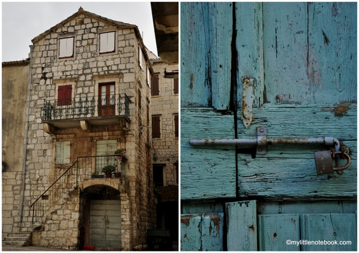 Wooden shabby doors in Komiza on Vis island
