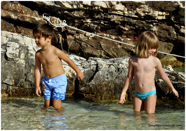 a boy and a girl playing in Adriatic sea