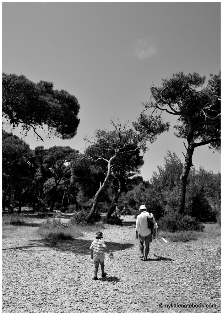 Father and son going to the Srebrna beach on the Vis island in Croatia