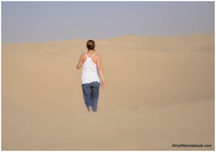 a woman in a desert walking