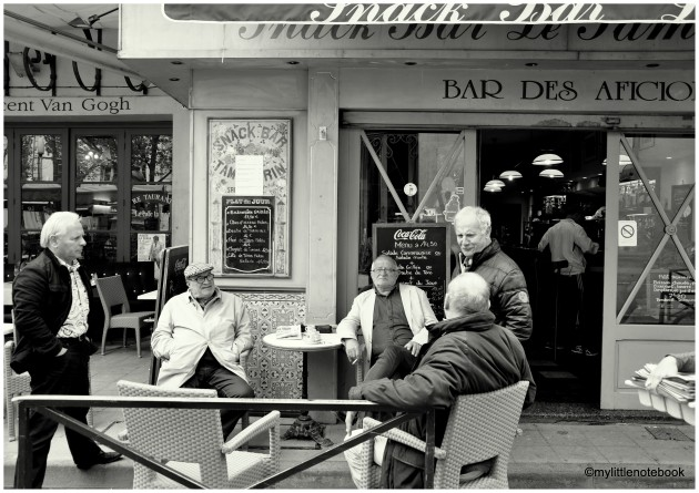 Men sitting and chatting in Arles